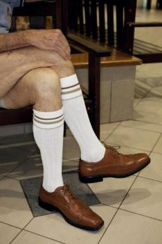 AUSTRALIA. Broome. Knee socks in the shopping centre. From 'No Worries'. 2011.